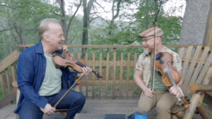 Picture of Chris and Casey laughing together while playing